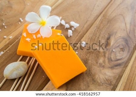 Soap set on a wooden background - stock photo