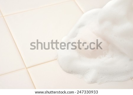Soap with bubble in bathroom - stock photo