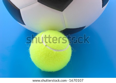 Soccer and tennis balls - stock photo