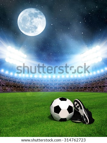 "Soccer ball and shoes in grass, soccer stadium with the dright lights. ""Elements of this image furnished by NASA"". - stock photo"