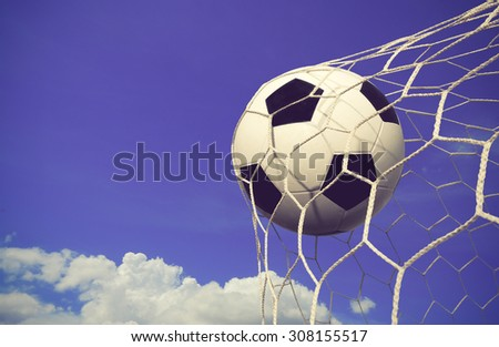 soccer ball and sky background color vintage - stock photo