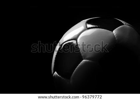 soccer ball detail on black background - stock photo
