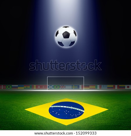 Soccer ball, green soccer stadium, arena in night illuminated bright spotlights, soccer goal, Brazil flag - stock photo