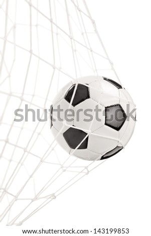 Soccer ball in a goal net isolated on white background - stock photo