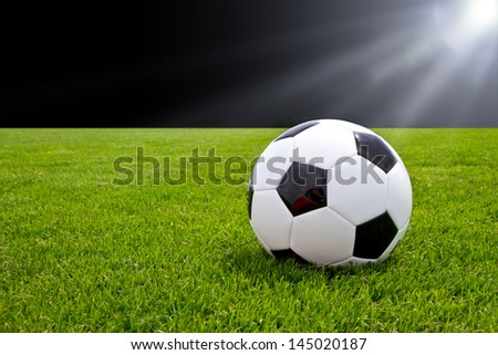 Soccer ball in a stadium - stock photo
