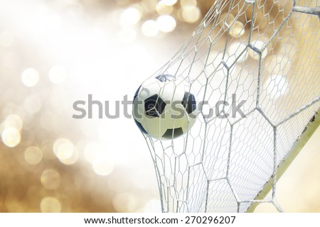 soccer ball in goal - stock photo