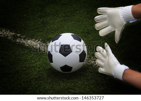 Soccer ball in goal protection of the goalkeeper  - stock photo