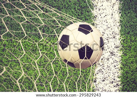soccer ball in goal vintage color - stock photo
