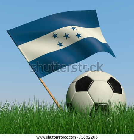 Soccer ball in the grass and the flag of Honduras against the blue sky. 3d - stock photo