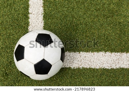 soccer ball on a soccer field - stock photo