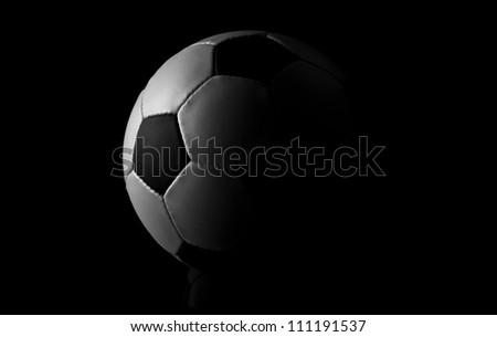 soccer ball on black background - stock photo