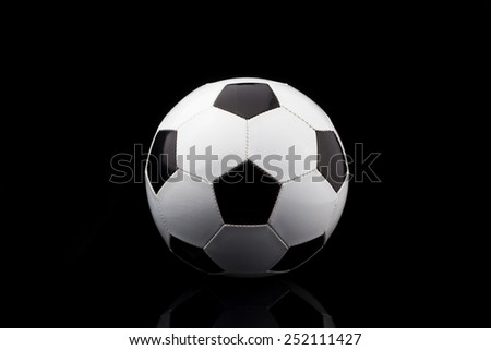 soccer ball on black background - stock photo
