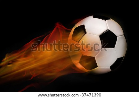 Soccer Ball on fire on a black background. - stock photo