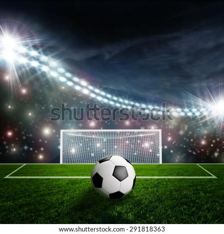 Soccer ball on green stadium arena - stock photo