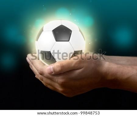 soccer ball on hand - stock photo