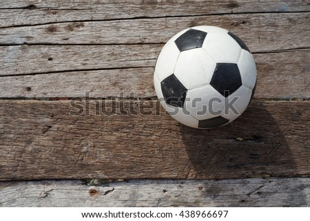Soccer ball on old wooden floor, Copy space - stock photo