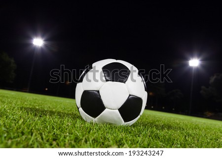 soccer ball on playing field - stock photo