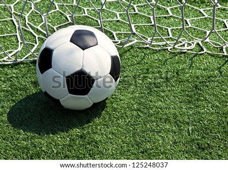 Soccer ball on the field in the grid - stock photo