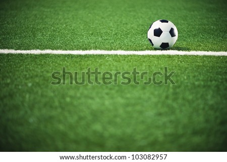 Soccer ball on the field over line - stock photo