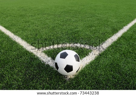Soccer ball on the field - shooting a corner - stock photo