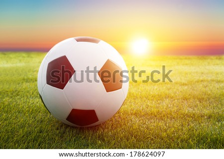 soccer ball on the field with sunset  - stock photo
