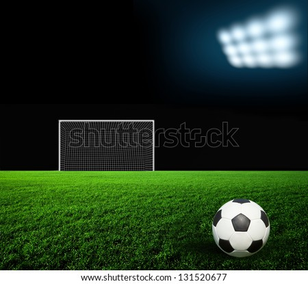 Soccer ball on the green field - stock photo