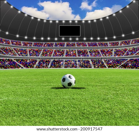 Soccer ball on the green field in stadium at daylight - stock photo