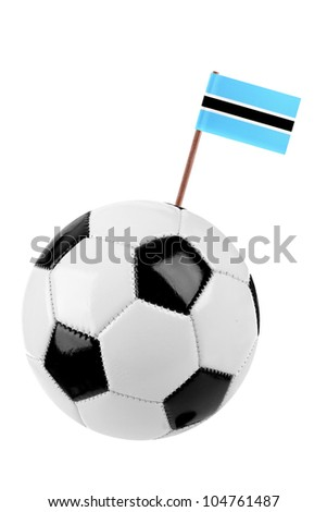 Soccer ball or football decorated with a small national flag of Botswana on a tooth stick - stock photo