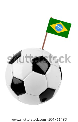 Soccer ball or football decorated with a small national flag of Brazil on a tooth stick - stock photo