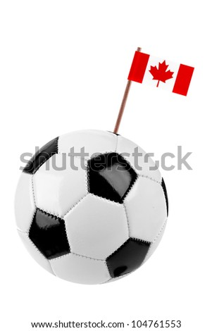 Soccer ball or football decorated with a small national flag of Canada on a tooth stick - stock photo