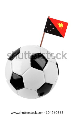 Soccer ball or football decorated with a small national flag of Papua New Guinea on a tooth stick - stock photo