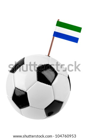 Soccer ball or football decorated with a small national flag of Sierra Leone on a tooth stick - stock photo