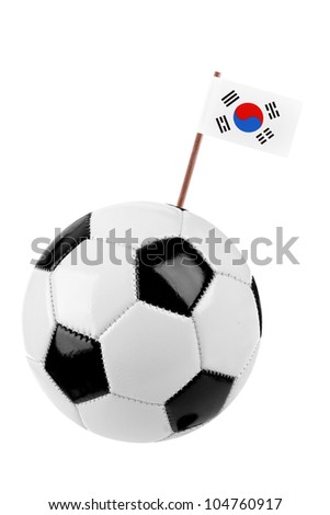 Soccer ball or football decorated with a small national flag of South Korea on a tooth stick - stock photo