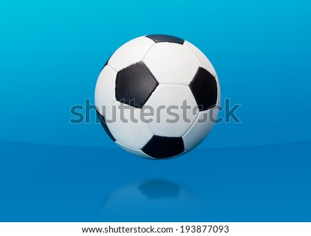 Soccer ball over blue background - stock photo