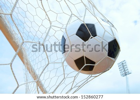 soccer ball shooting in goal touch net agent the sky - stock photo