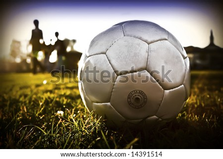 Soccer ball with people silhouette t01 background - stock photo