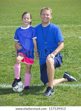 Soccer Coach and Soccer Player portrait - stock photo