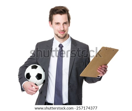 Soccer coach hold with ball and plan - stock photo