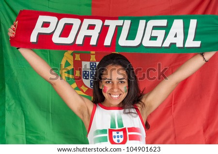 Soccer fan with a portuguese scarf - stock photo