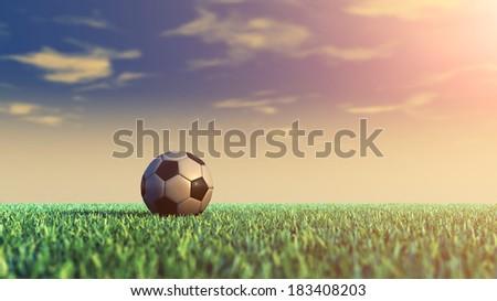 Soccer field and ball , daylight - stock photo