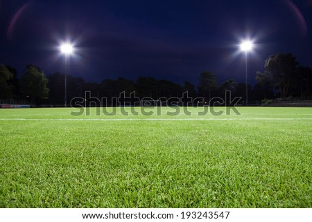 soccer field with spot lights (background) - stock photo