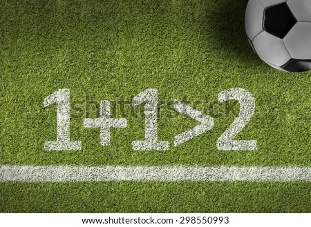 Soccer field with the text: 1+1>2 - stock photo