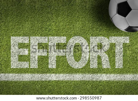 Soccer field with the text: Effort - stock photo