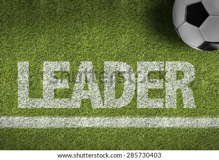 Soccer field with the text: Leader - stock photo