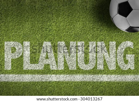 Soccer field with the text: Planning (in German) - stock photo