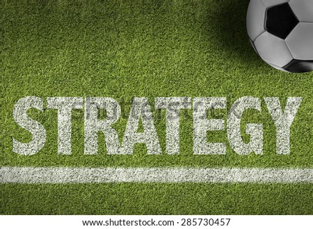 Soccer field with the text: Strategy - stock photo