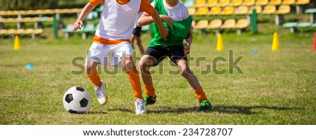 Soccer football game match for children. Kids playing training and football soccer tournament - stock photo