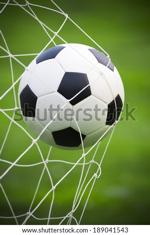 soccer football in goal net - stock photo