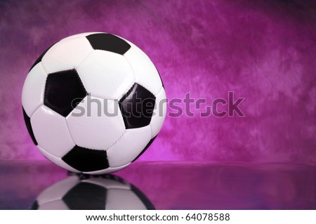 Soccer football on brilliant purple background with copy space - stock photo