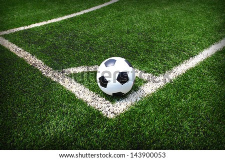 Soccer Football on the Green Grass Texture in Soccer Field - stock photo